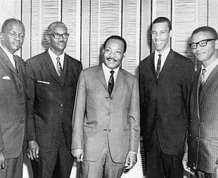 Rev. Lawson, second from right, with Dr. Martin Luther King Jr., middle.