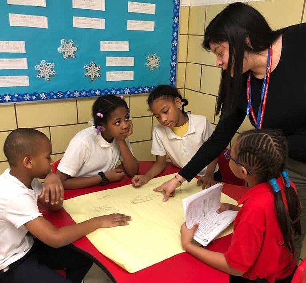Michelle Silva is shown with her students before schools were closed for the remainder of the year. Photos provided by Chicago Public Schools