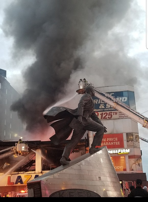 Stunned onlookers used their phones and social media to record the fire that burnt out one of Harlem's 125th Street ...