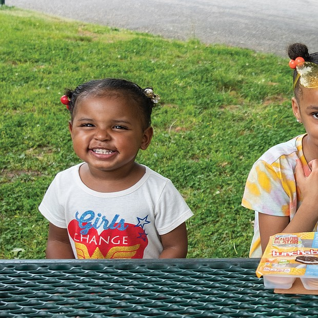 Harmony Johnson, 3, left, and her cousin, 6-year-old London Johnson, have lunch last Friday in Forest