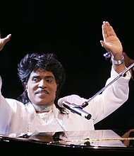 """Little Richard performs in 2004 at the Westbury Music Fair in Westbury, N.Y. The self-proclaimed """"architect of rock 'n' roll"""" whose piercing wail, pounding piano and towering pompadour irrevocably altered popular music while introducing black R&B to white America,  died Saturday, May 9, 2020. (AP photo)"""