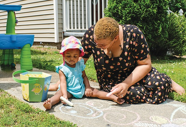 Art captivates people of all ages, even 15-month-old Ava Spurlock. The toddler helped her mother, LaRonda Malone, create colorful chalk sidewalk art last Saturday in the 1000 block of 23rd Street in the East End.
