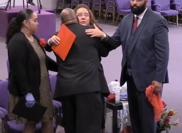 Mother Marcietia S. Glenn, first lady of New Deliverance Evangelistic Church in Chesterfield County, is comforted during the funeral last ...