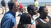 Gov. Northam poses for photos with beachgoers Saturday at Virginia Beach. He, like many others, was not wearing a face mask or socially distancing as he and health officials have called for to help curb COVID-19.