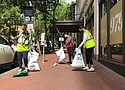 Volunteers joined SOLVE and Starbucks in Pioneer Courthouse Square Tuesday to cleanup downtown Portland after four days of protests that brought thousands of demonstrators downtown.