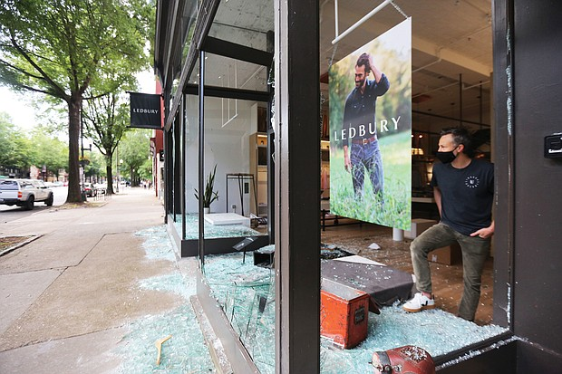 Paul Trible, owner of menswear and shirtmaker Ledbury, looks out of the glassless window of his storefront at 315 W. Broad St., one of the Downtown stores that was looted.