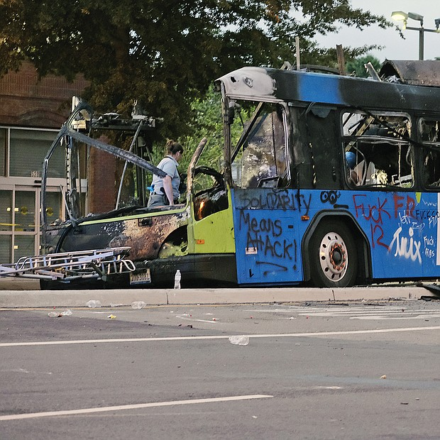 The burned out hulk of a GRTC Pulse bus was still at Belvidere and Broad streets as the sun rose — one of the most visible signs of the violence that took over the protest Friday night.