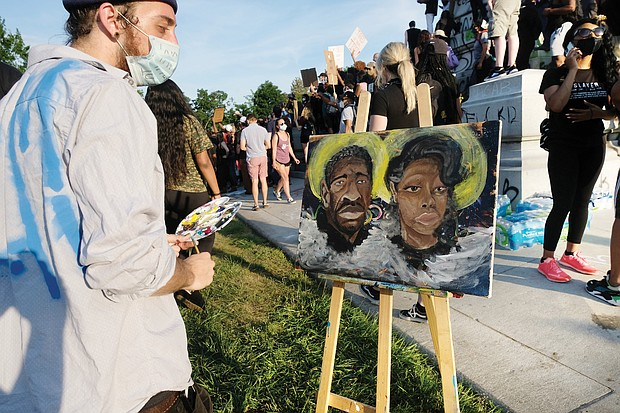 in the midst of the crowd gathered Tuesday at the Lee statue, Kyle Rudd paints a picture honoring George Floyd of Minneapolis and Breonna Taylor of Louisville, both victims of police violence. The march and rally around him on Tuesday was peaceful.