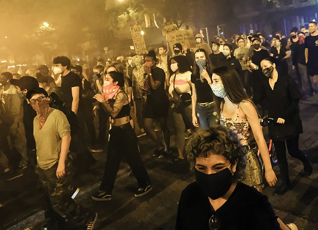 The flood of protesters, most masked against the coronavirus, turned off Broad Street and flow onto 2nd Street on their way to the State Capitol in what was then a peaceful action.