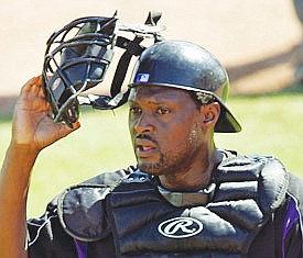 African-American baseball catchers are a vanishing breed.