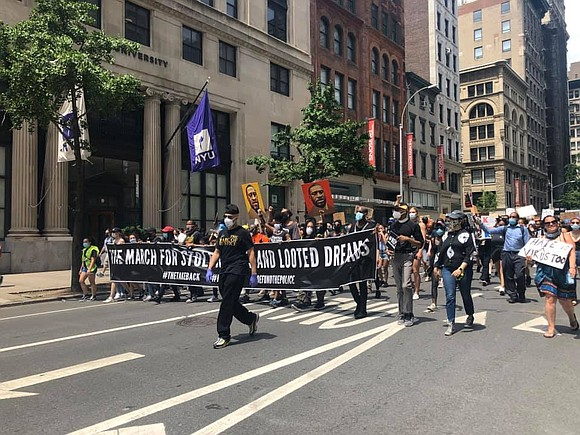 Hundreds of people gathered in Harlem Saturday for a peaceful rally and march against police brutality.