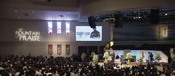 The Black man whose death has inspired a worldwide reckoning over racial injustice was buried in Pearland, Texas Tuesday, carried ...
