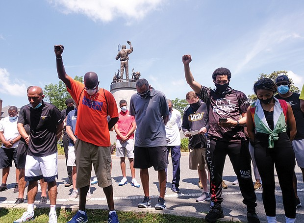 Coaches representing at least 100 schools and various sports participate during last Saturday's rally and march that started at the statue of tennis great Arthur Ashe Jr. and proceeded down Monument Avenue to the Lee statue. The coaches want to be a voice for change for area youths.