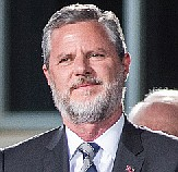Liberty University President Jerry Falwell Jr. apologized Monday for a tweet that included a racist photo that appeared on Gov. ...