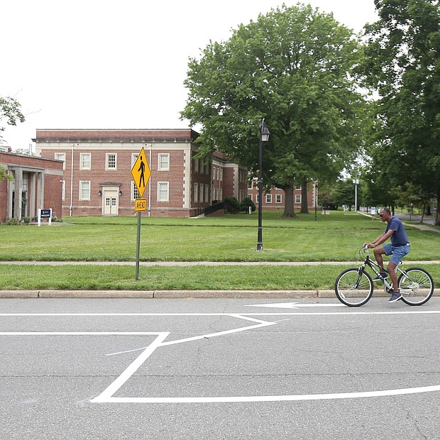 A cyclist pedals along one of the newly installed bike lanes on Brook Road near Westbrook Avenue. A sign explains that parking is allowed to the left in a former travel lane, while bikes stay to the right. More than $1 million in federal funds was spent to install the 3.5-mile stretch in Richmond of bike lanes along Brook Road between Azalea Avenue and Charity Street. Providing room for bikes and street parking is restricting vehicle traffic to one lane in each direction on Brook Road, although there are turn lanes for vehicles at major intersections. Work began after City Hall shut down in mid-March due to the pandemic and is essentially complete. The total $1.5 million installation project also included funding for bike lanes on Malvern Avenue and a portion of Patterson Avenue, according to the city Department of Public Works.