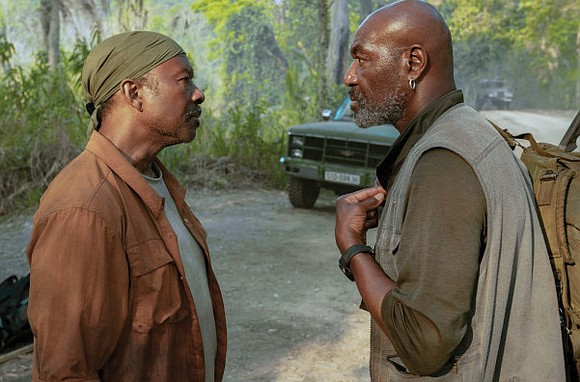 """In the jungle of Spike Lee's sprawling and anguished """"Da 5 Bloods,"""" Delroy Lindo's titanic performance as a Vietnam veteran ..."""