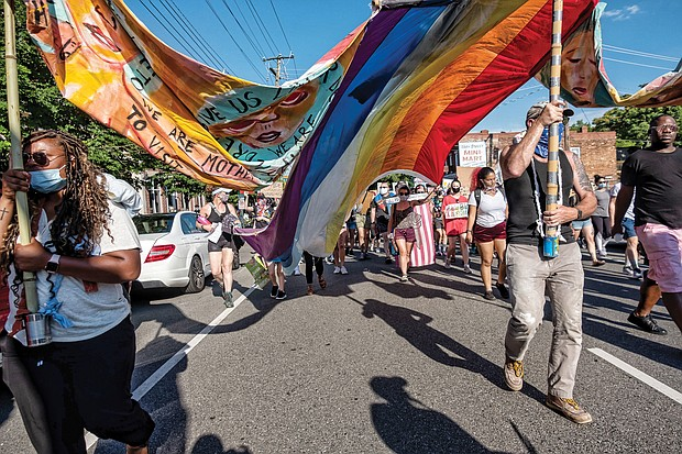 Hundreds of demonstrators march in support of Black Lives Matter and Richmond's LGBTQ+ community on June 12, the four-year anniversary of the deadly Pulse nightclub rampage in Orlando, Fla., where 49 people were killed.