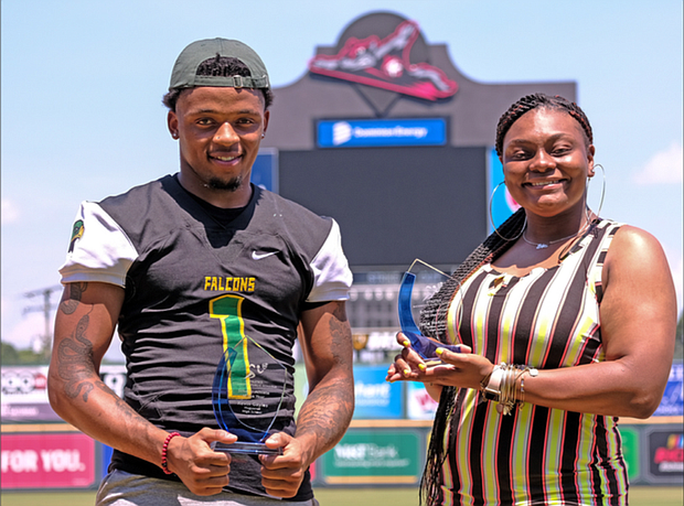 Kevin Gayles of Huguenot High School and Jayla Henderson of Thomas Jefferson High School display their awards as the Richmond Public Schools 2020 Scholar-Athletes during a June 4 event at The Diamond.