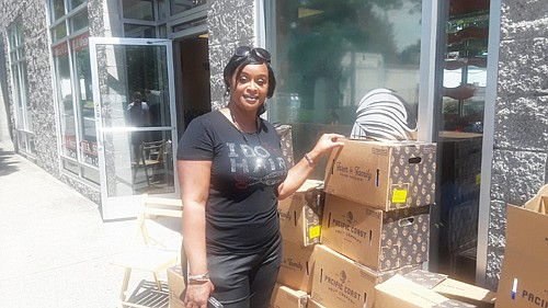 Erica Fahnbulleh, owner of Essence Hair Design, 4710 N.E. Martin Luther King Jr., reopens her business under new Phase One coronavirus regulations for public safety, while reaching out to distribute free food boxes from the Sunshine Division for those in need each Thursday from 11 a.m. to 2:30 p.m.  On Friday, Multnomah County was officially reopened for business under the state's re-opening process, requiring safe distancing between people and masks to be worn in all public places.