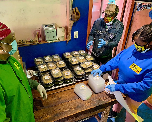 LoLo's owners prepare WCK meals for delivery