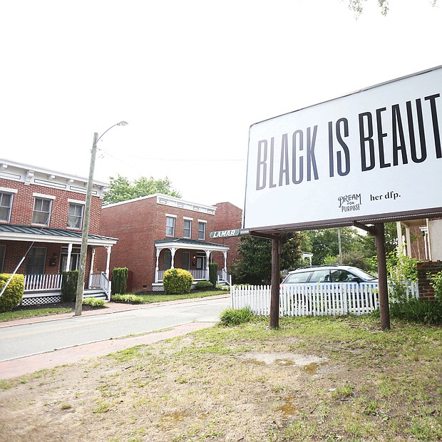 "This ""Black is Beautiful"" billboard stands at the corner of Jackson Street and Chamberlayne Parkway on the edge of Jackson Ward and just across Interstate 95 from Gilpin Court. It's a message that resonates amid the upheaval in the city. The billboard is the work of Dream for Purpose, which describes itself on its website as a ""research-led creative house that provides brands with guidance and insights on how to maneuver in an ever-changing digital age."""