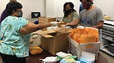 From left, Mary Carter, Sharon Stone and Arqam Ahsan with the state Department of Medical Assistance Services pack masks and other personal protection equipment for home health care workers who aid thousands of elderly and disabled Virginians with bathing, dressing, toileting and meals under the Medicaid program.