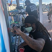 Jr, Deonte Ward, and Jeff Huntington paint a mural of George Floyd and others who have lost their lives to police brutality. The mural is located in Susan Campbell Park in downtown Annapolis.