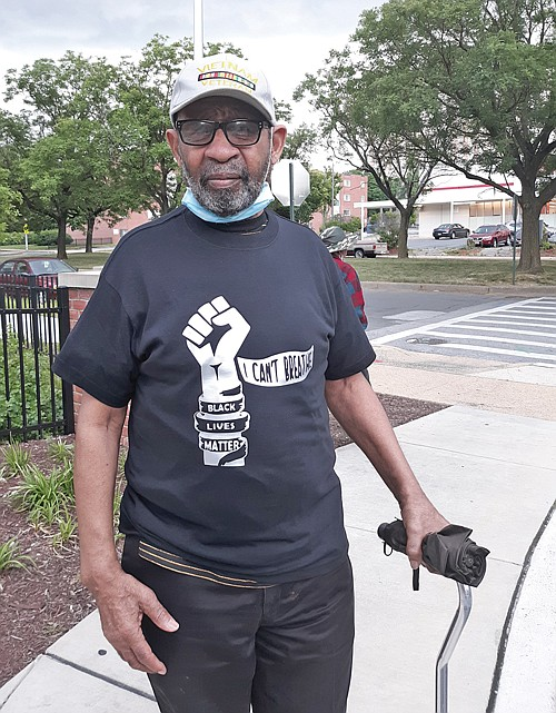 """Ronald Curtis dons an """"I Can't Breathe"""" Black Lives Matter t-shirt to show support for the demonstrations against police brutality and racial injustice."""
