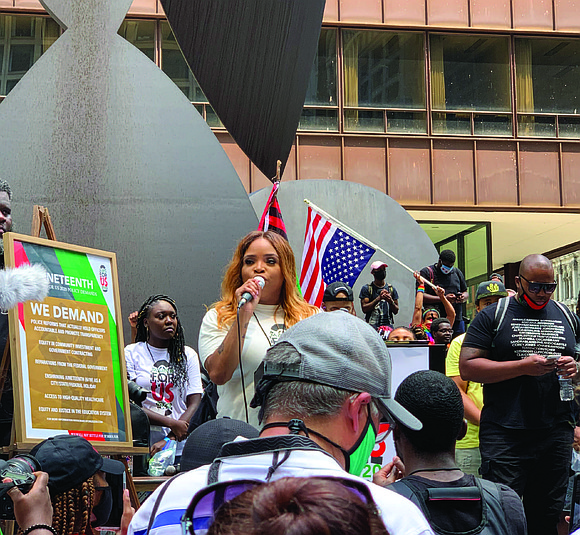 On Friday, June 19, marchers took to the streets of downtown Chicago, holding Black Lives Matter signs while a brass ...
