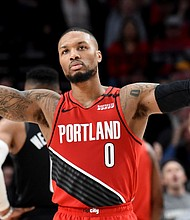 Portland Trail Blazers guard Damian Lillard urges on the crowd after scoring during an NBA basketball game against the Houston Rockets in Portland last Jan. 29.  The Blazers won 125-112.  (AP photo)