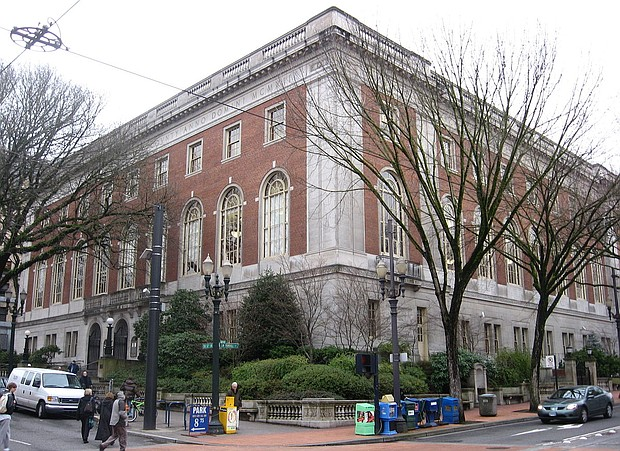 The Multnomah County Central Library, downtown, is shown in this photo from wikipedia commons. A new policy by the library system eliminates all late fines for library materials, but retains billing for unreturned items.