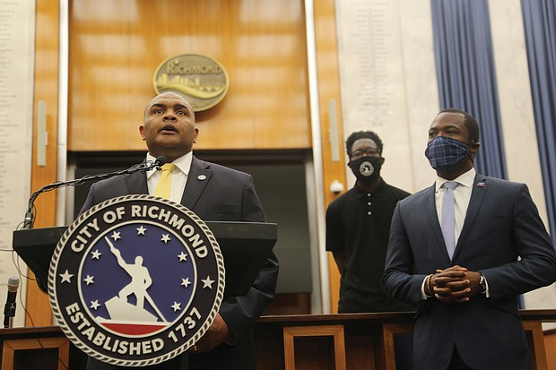 """""""I'm listening,"""" new Richmond Police Chief Gerald M. Smith says at a City Hall press conference Saturday after Mayor Levar M. Stoney, right, introduced him. """"My office, my phone line, my email is open to you, so let's have a conversation."""" The city's 20th chief began work Wednesday."""