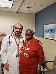 Dr. Christian Rolfo and patient Carol Pitts Wilson. Dr. Rolfo is treating Pitts Wilson for a carcinoid tumor.