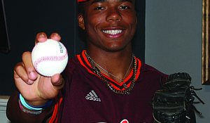 Zion Rose, a 15-year-old sophomore at Chicago's Brother Rice High School, is one of the top ranked baseball players in the country, and when he is not playing ball, he is on his laptop dabbling in online trading. He plans to become an engineer or a stock broker, if baseball does not work out for him professionally. Photo credit: By Wendell Hutson