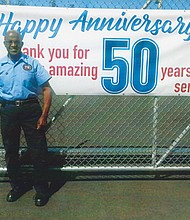 PepsiCo honors Bill Jackson with a banner and his picture on a can of Pepsi for his 50 years of service as an employee at the company's distribution center in northeast Portland