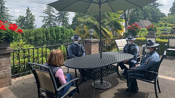 Gov. Kate Brown sat down with Oregon State troopers on Friday just two days after they were recorded on survelliance ...