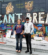 "Joe ""Bean"" Keller is leading a delegation of Portland families like his own who have lost loved ones to police violence to attend the 57th anniversary of the March on Washington this coming Aug. 28. He is pictured with artist Emma Berger, creator of a mural calling attention to the death of his son, Deontae, and other black men and women who lost their lives at the hands of police in Portland. The mural is located in front the Apple store on Southwest Yamhill, downtown."