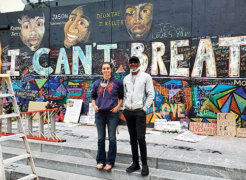 """Joe """"Bean"""" Keller is leading a delegation of Portland families like his own who have lost loved ones to police violence to attend the 57th anniversary of the March on Washington this coming Aug. 28. He is pictured with artist Emma Berger, creator of a mural calling attention to the death of his son, Deontae, and other black men and women who lost their lives at the hands of police in Portland. The mural is located in front the Apple store on Southwest Yamhill, downtown."""