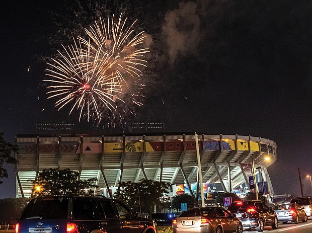 Traffic stops along Arthur Ashe Boulevard last Saturday as drivers and their passengers watch the Fourth of July fireworks display over The Diamond.
