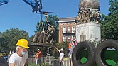 Sculptor Paul DiPasquale prepares the place on the flatbed truck where the statue of Confederate naval commander Matthew Fontaine Maury will be placed. The bronze statue was taken down July 2 under the watchful eye of Mr. DiPasquale, a consultant to the city on removing the statues.