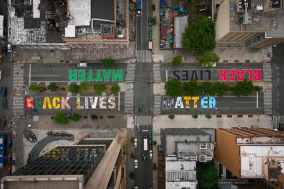 Manhattan's site for the Black Lives Matter mural was organized by Harlem Park to Park, featuring work of Harlem artists ...