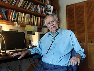 """Author Rudolfo Anaya poses for a photograph in his New Mexico home writing studio in June 2016. Mr. Anaya, who helped launch the 1970s Chicano literature movement with his novel, """"Bless Me, Ultima,"""" died Sunday, June 28, 2020, after a long illness."""
