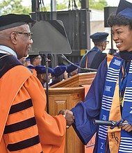 Dr. Wilson congratulates a Morgan graduate during convocation ceremonies at Morgan State University.
