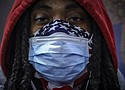 A subway rider wears a mask and a bandana to protect himself against COVID-19 in New York. As the coronavirus tightened its grip across the country, it is cutting a particularly devastating swath through an already vulnerable population, black Americans. (AP photo)