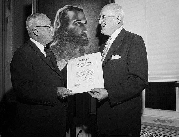 "The Rev. J. Manning Potts of Nashville, Tenn., left, presents the 1957 Upper Room Award for World Christian Fellowship to artist Warner Sallman of Chicago at a dinner meeting of church and government offficials on Oct. 3, 1957, at the National Press Club in Washington, D.C. Mr. Sallman was honored for his ""Head of Christ"" painting shown in the background."