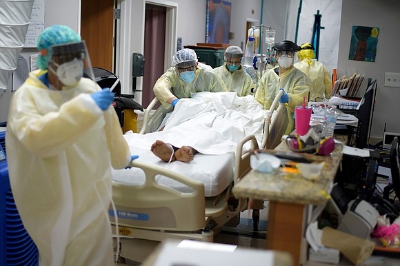 Battles over wearing face coverings intensified even as the US shattered another daily coronavirus record and health officials warned hospitalizations ...