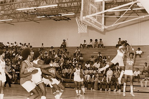 A city of Portland archive photo shows Jefferson High School basketball players during an all-star basketball game at Jefferson High School in 1972. A local author is reaching out for archival material for a book he is writing on the team which won the 1971-72 state championship while comprised entirely of African American players against an all-white team from Baker City.