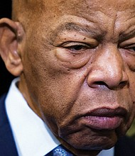 U.S. Rep. John Lewis, D-Ga., is pictured last December before an event with fellow Democrats before passing the Voting Rights Advancement Act to eliminate state and local voter suppression laws. Lewis died Friday at the age of 80.