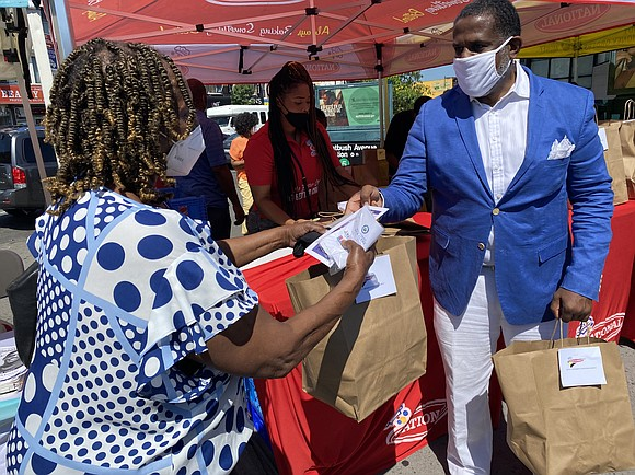State Sen. Kevin Parker teamed up with Jamaican Consul General Alsion Roach Wilson to distribute over 400 boxes of baked ...