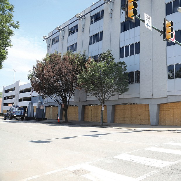 The barriers were removed last weekend, enabling westbound traffic to move past the building again. police several nights, resulting in officers firing tear gas and rubber bullets into the crowds. The concrete bar- riers were installed after the tires were slashed on dump trucks that initially were used as barriers and the front door to the headquarters building was damaged. New Police Chief Gerald M. Smith authorized the barriers to be removed after the front door was fixed and most of the trucks were removed. Before the installation, the department put high priority on protecting the building after a Minneapolis police building was torched following the police killing of George Floyd on May 25 in Minnesota. Also prompting the barriers was a rumor that protesters would attempt to ram the building with a tractor-trailer. No attempt was made.